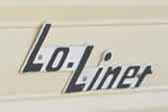 Vintage Lo-Liner travel trailer with original Lo-Liner logo script emblem.