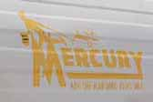Mercury vintage travel trailer with a yellow Merdcury logo graphics decal on the front