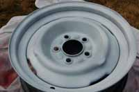 Photo of the trailer wheel after we sprayed on 2 coats of the gloss white paint
