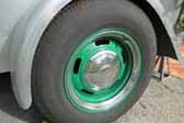 Here is a great example of a vintage teardrop trailer with after-market wheels painted green, and with a small hubcap