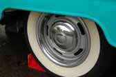 Heres what after-market wheels painted silver with a chrome hubcap, beauty rings and wide whitewalls look like on a vintage shasta trailer