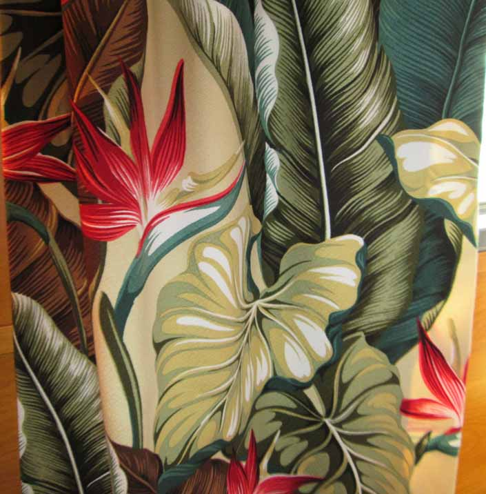 This photo shows a swatch of retro fabric with a beautiful hawaiian tropical flowers pattern, for your vintage trailer
