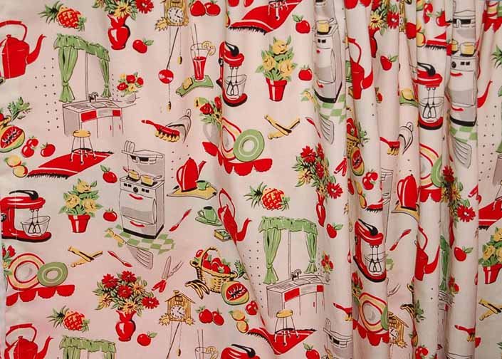 This photo shows a swatch of retro fabric with a happy kitchen appliances illustrations pattern, for your vintage trailer