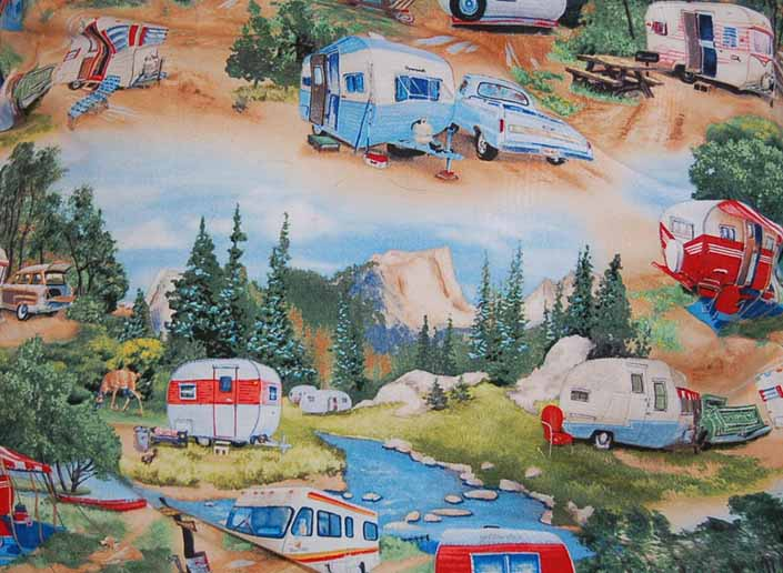 This photo shows a swatch of retro fabric with vintage trailers, station wagons and pickup trucks, for your vintage trailer