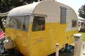 Stunning Early Shasta Trailer paint bright yellow and white