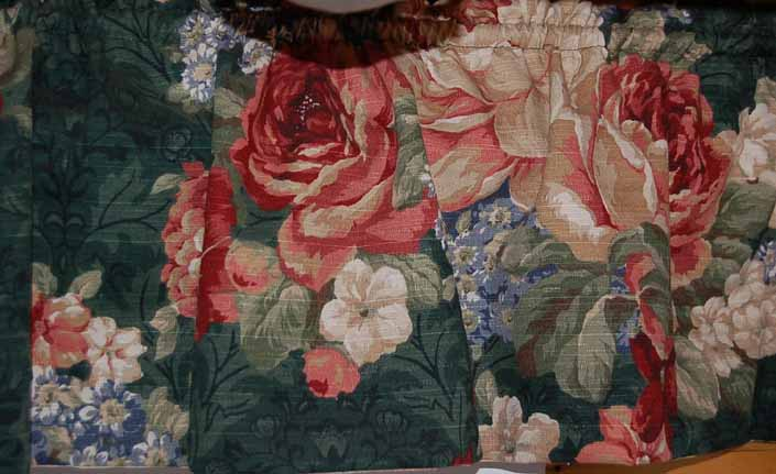 This photo shows a swatch of retro fabric with an old-fashioned muted florals design, for your vintage trailer