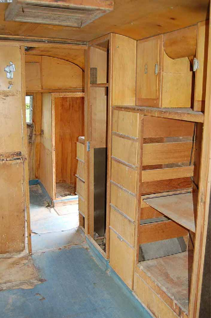 Worn but restorable interior woodwork in a 1947 Westcraft vintage trailer for sale at Pismo Trailer Rally