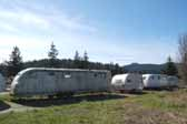 Photo of a group of vintage trailers from the 50's and 60's stored in a vintage Trailer Junk Yard