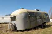 A painted older Airstream Trailer stored in a Vintage Trailer Junk Yard