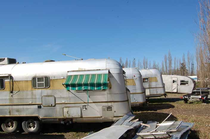 Vintage trailer junkyard has a group of Silver Streak and Spartanette trailers available for restoration