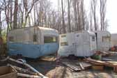 Photo of vintage canned ham trailers in junkyard