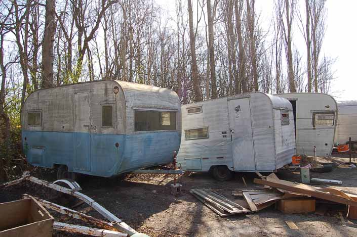 Project trailers for restoration, stored in a Vintage Trailer Junkyard