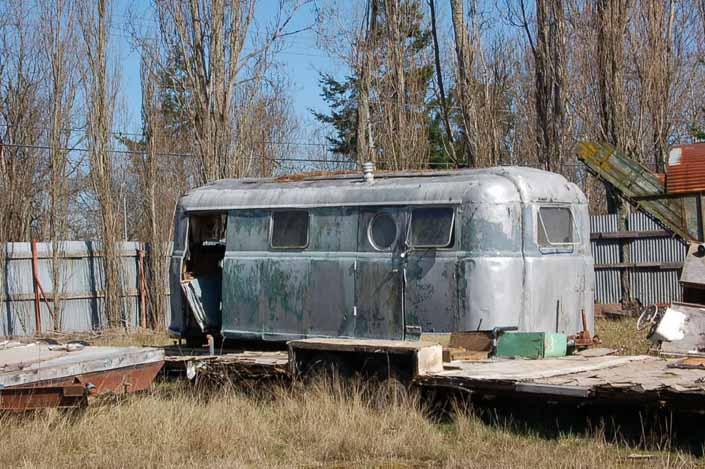 Vintage trailer junk yard has a rare Palace vintage trailer ready to be restored