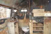 Vintage trailer storage yard has a Shasta trailer heavily damaged by an interior fire