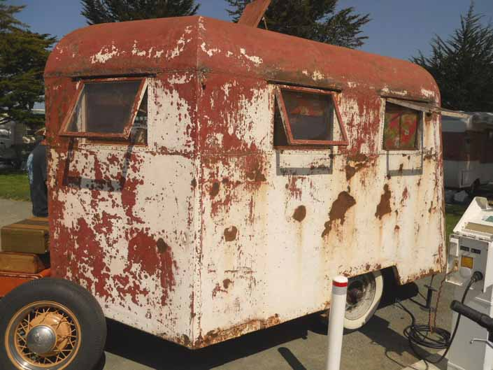 1936 Covered Wagon trailer in a vintage trailer StorageYard is a great restoration project