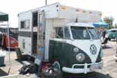 Large custom camper unit combined with a vintage split-window Volkswagen bus, is a roomy and classic truck-based camper