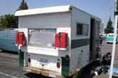 Awesome custom truck based trailer camper combined with a classic VW bus, kept the original vw bus engine access door